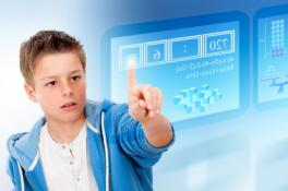 Boy touching a screen that is in the air and transparent.